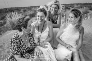 Séance photo sur la plage en famille